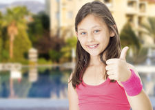 Child girl athlete. Shows sign okay royalty free stock images