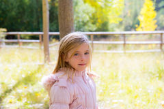 Child girl in autumn outdoor nature landscape Royalty Free Stock Photography