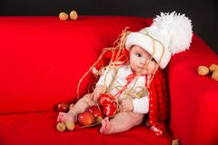 Child girl baby with christmas decoration Stock Images