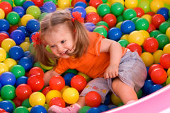 Child girl and  ball group on playground in park. Royalty Free Stock Image