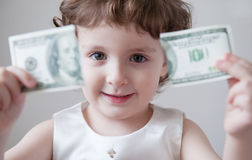 Child girl bank currency dollar finance system   break   unemployment crisis Stock Photos