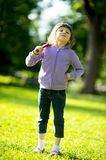 Child girl with baseball bat in park Stock Photography