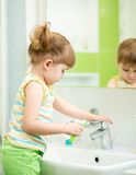 Child girl in bathroom Royalty Free Stock Photo