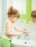 Child girl in bathroom Royalty Free Stock Photo