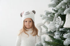 Child girl in bear hat dream at christmas time Royalty Free Stock Photo