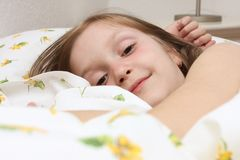 Child girl at the bed Royalty Free Stock Images
