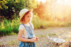 Child girl with bicycle on country road Royalty Free Stock Photos