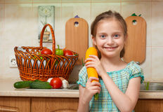 Child girl with big cabbage, vegetables and fresh fruits in kitchen interior, healthy food concept Stock Photos