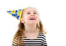 Child girl in birthday cone hat royalty free stock photos