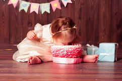 Child girl biting cake Stock Images