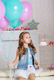 Child girl is blowing candle on birthday cake Royalty Free Stock Photography