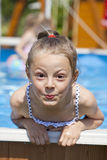 Child girl in blue bikini near swimming pool. Hot Summer. Happy little Girl in blue bikini swimming pool Royalty Free Stock Photo