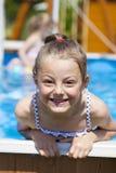 Child girl in blue bikini near swimming pool. Hot Summer Royalty Free Stock Images