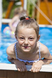 Child girl in blue bikini near swimming pool. Hot Summer. Happy little Girl in blue bikini swimming pool Stock Images