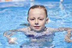 Child girl in blue bikini near swimming pool. Hot Summer Royalty Free Stock Photography