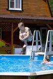 Child girl in blue bikini near swimming pool. Hot Summer Stock Photo