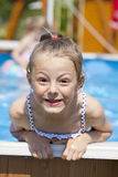 Child girl in blue bikini near swimming pool. Hot Summer. Happy little Girl in blue bikini swimming pool Royalty Free Stock Photos