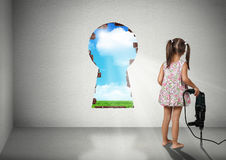 Child girl break wall shape of keyhole, cognition creative conce. Child girl break wall, cognition creative concept royalty free stock photography
