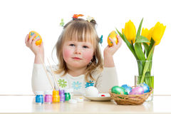 Child girl with brush coloring easter eggs. Kid girl with brush coloring easter eggs isolated royalty free stock images