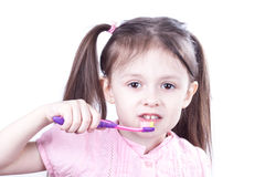 Child girl brushing teeth isolated on white background Royalty Free Stock Images