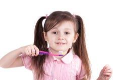 Child girl brushing teeth isolated on white background Royalty Free Stock Photos