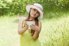 Child girl with bucket of strawberries Royalty Free Stock Photo