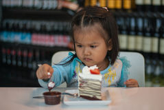 Child girl and cake. Focus on cake stock image