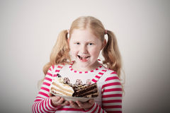 Child girl with cake Royalty Free Stock Photos
