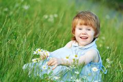 Child girl with camomile daisy Royalty Free Stock Image