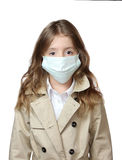 Child girl caucasian in medicine mask isolated on white. Royalty Free Stock Photos