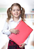 Child girl caucasian pupil hold folder school education. Stock Images