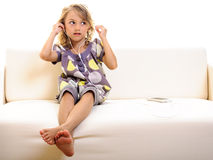 Child girl cell phone earphones Stock Photography