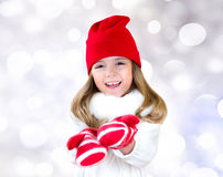 Child Girl Christmas Clothes Stretching Empty Hands. Stock Image