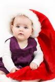 Child girl with Christmas santa hat Stock Photo