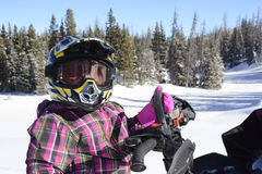 Child , girl, closeup riding snowmobile Royalty Free Stock Images