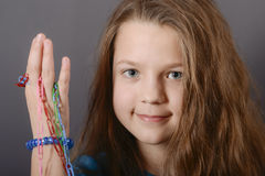 Child girl with color clips Stock Images