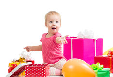 Child girl with colorful balloons and gifts Stock Photography