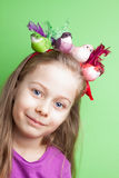 Child girl with colorful birds on her head on green Royalty Free Stock Photo