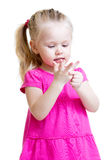 Child girl counting on fingers of her hands Royalty Free Stock Photo