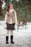 Child girl on cozy warm outdoor winter walk Royalty Free Stock Photo