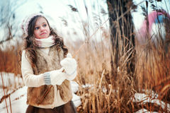Child girl on cozy warm outdoor winter walk Royalty Free Stock Image
