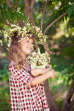 Child girl with daisies Stock Image