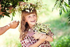 Child girl with daisies Stock Photo