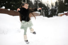 Child girl dances in the snow Royalty Free Stock Photos