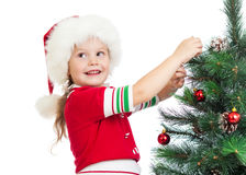 Child girl decorating Christmas tree isolated Royalty Free Stock Image