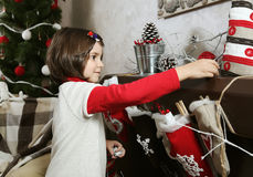 Child Girl Decorating Room for Christmas Royalty Free Stock Images