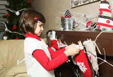 Child Girl Decorating Room for Christmas Stock Images