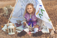 Child girl in decorative hovel on the nature Stock Photography