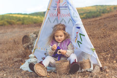 Child girl in decorative hovel on the nature Stock Image