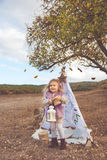 Child girl in decorative hovel on the nature Royalty Free Stock Photography